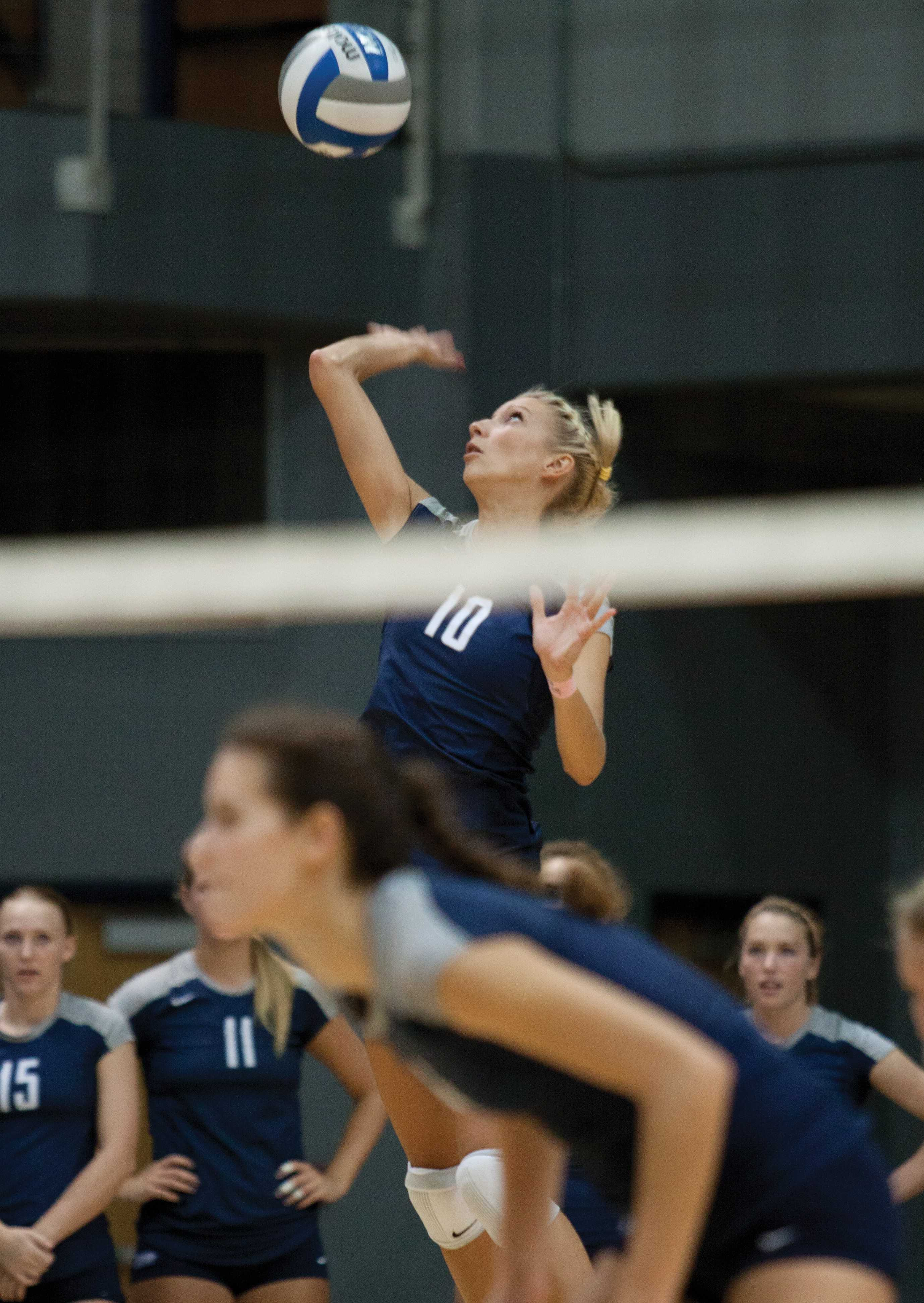 UNF's Dagnija Medina (10) elevates for a serve.