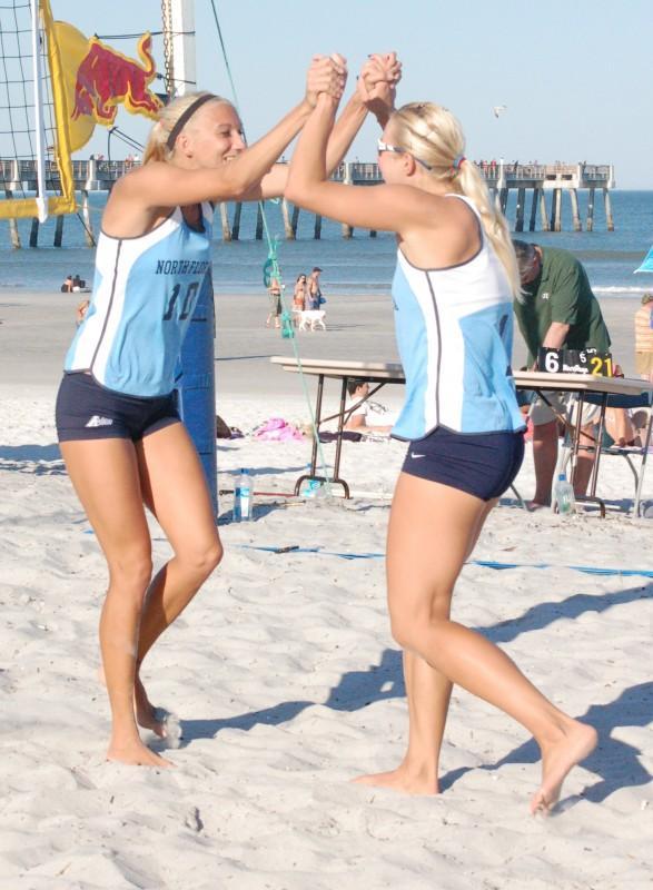 Photo Credit: Travis Gibson Anna Budinska and Dagnija Medina celebrate at a match against JU.