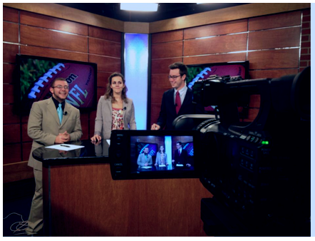 Station Manager Connor Spielmaker on right, on the set with News Director Kelly Lindstrom in middle and Sports Anchor Josh Brannock.