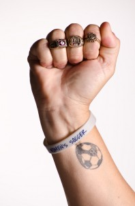Linda Hamilton displays her championship rings. Photo by Ali Blumenthal