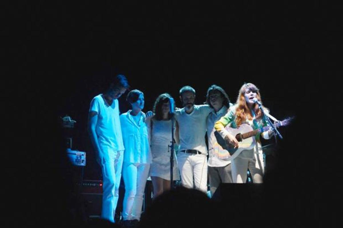 """Lewis began her set with """"Just one of those Guys,"""" with a band of women and men dressed in white behind her. Photo by Michaela Gugliotta"""