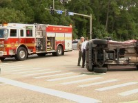 Breaking: red Jeep overturned at UNF Drive and Alumni Drive intersection
