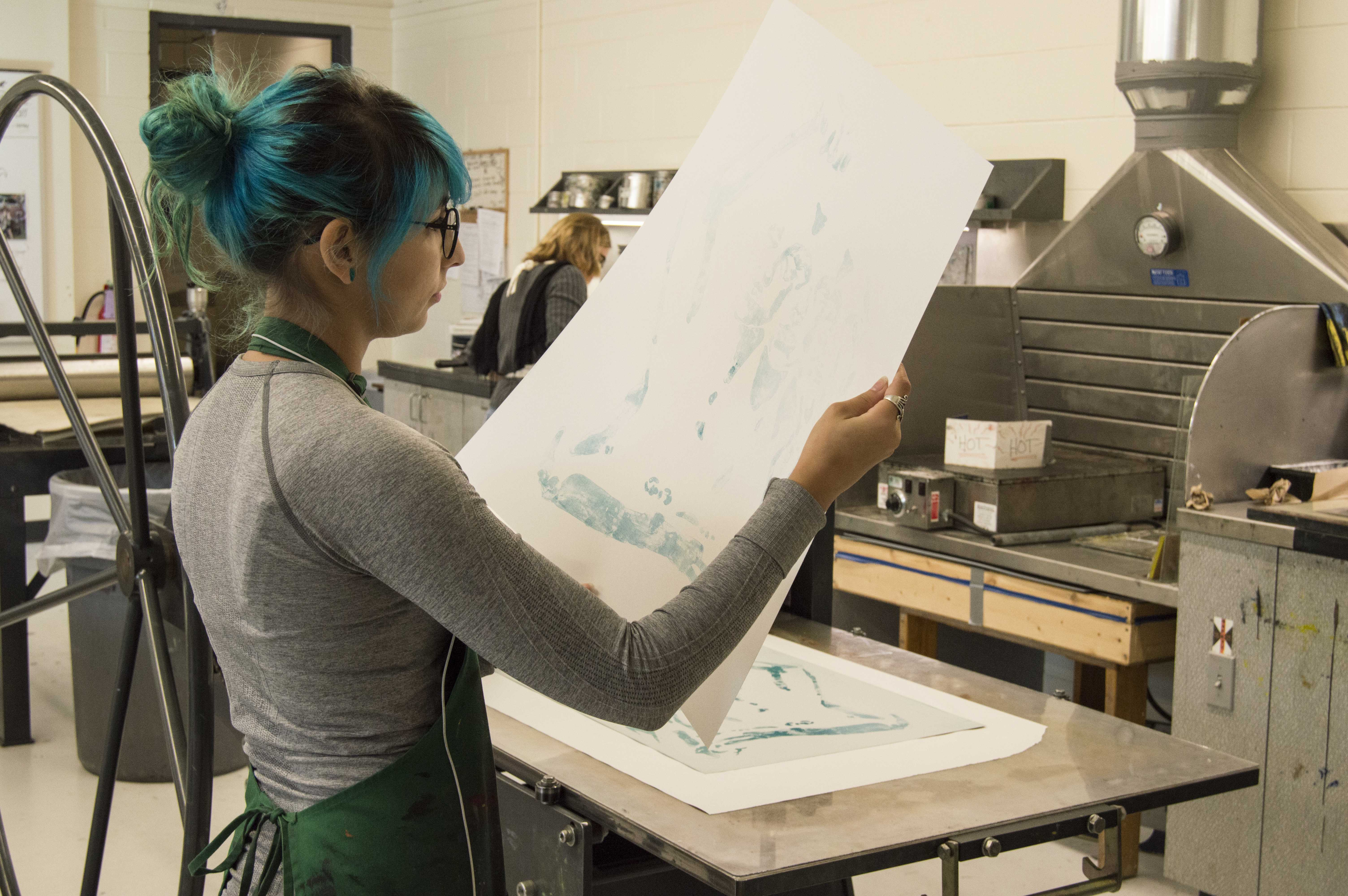 Brittany Gorelick works on a printmaking project in the Fine Arts Building. Printmaking classes are offered through the Art and Design Department.   <i>Photo by Cassidy Alexander</i>