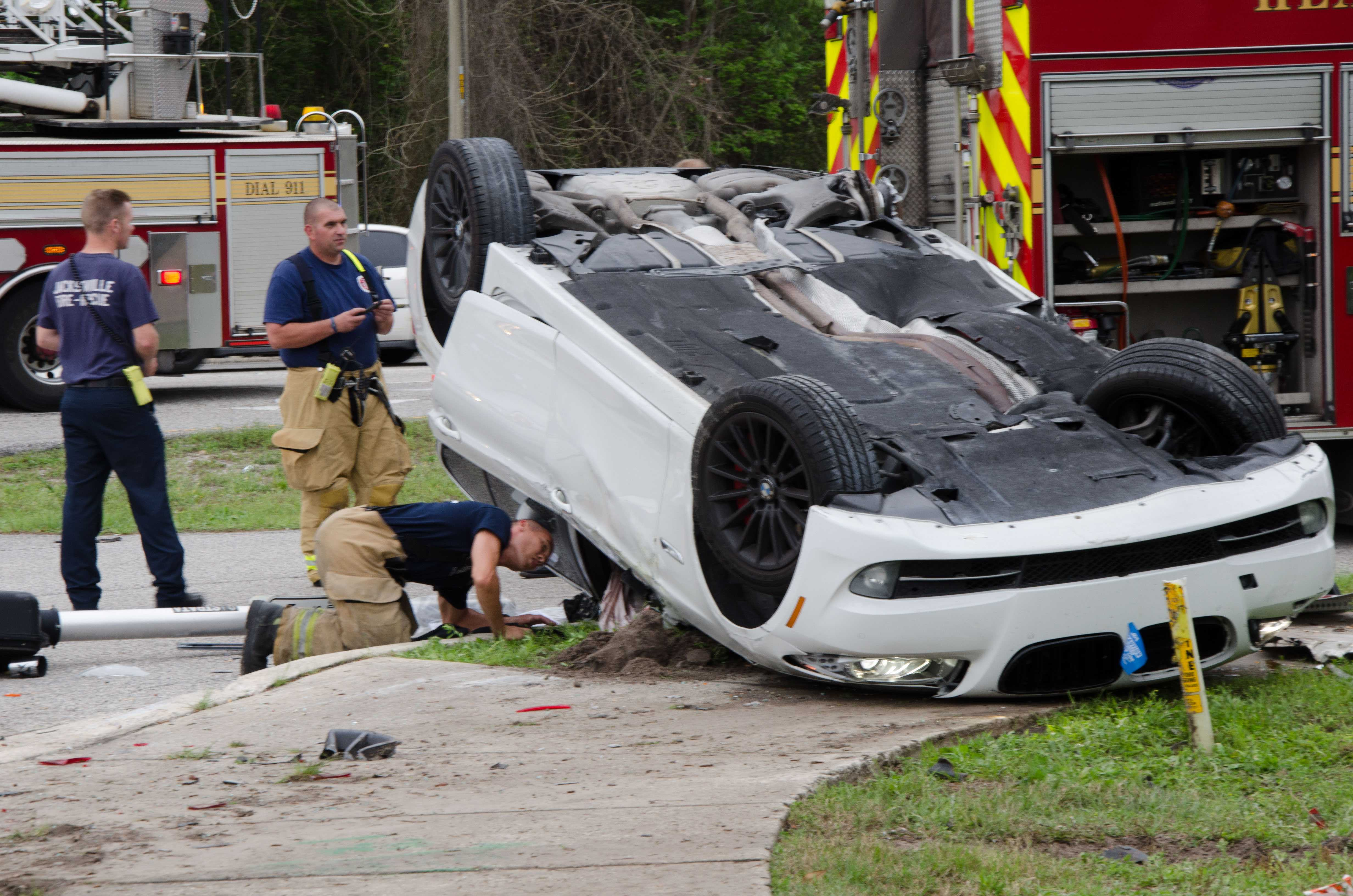 VIDEO: Two-car rollover shuts down Alumni Drive; drivers transported to hospital