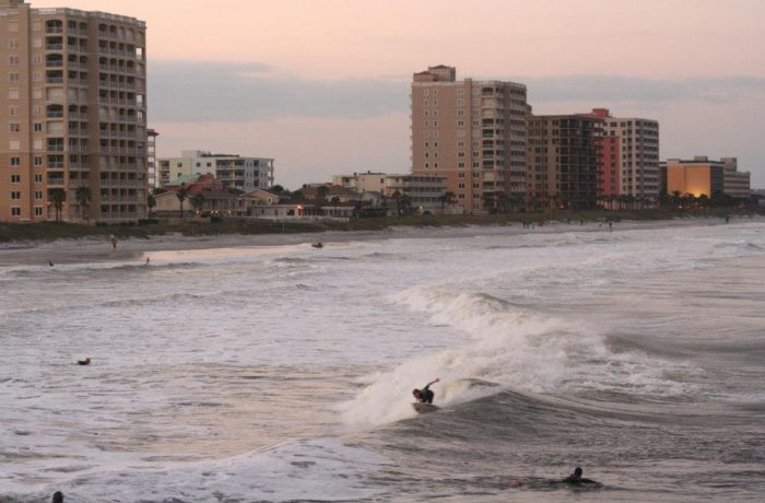 A few surfers ride post-storm waves in Jacksonville Beach.  Photo by Mark Judson