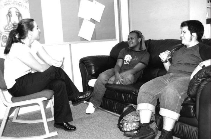 Emily Rokosch, LGBT education coordinator, chats with students Marcus Google and Dean Bonilla at the office on campus.  Photo from UNF Spinnaker Print Archives