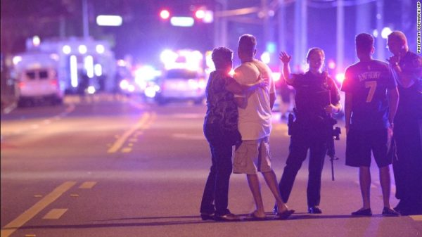 Family members being evacuated from the scene of the shooting. Photo courtesy of CNN.