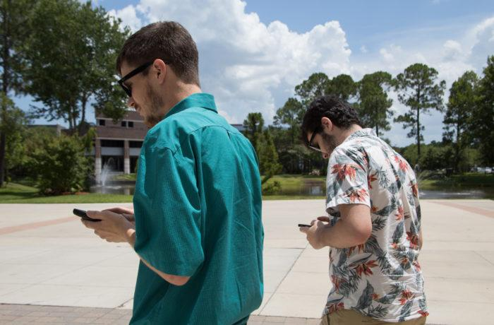 Students play Pokemon Go on campus. Photo by Jenn Mello.