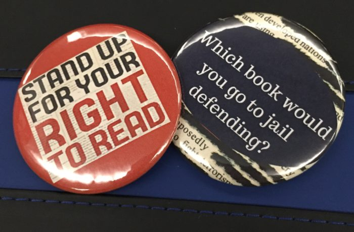 The library is handing out buttons supporting individuals right to read. Photo by Hannah Lee
