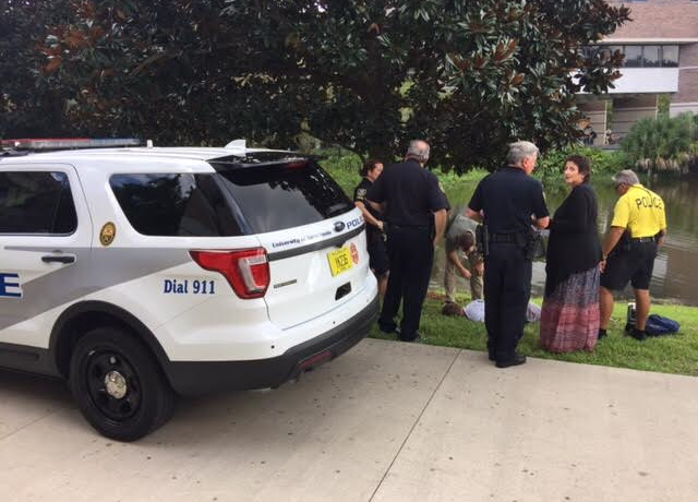 Police handcuffed a man who witnesses say yelled at a student in the library and screamed about ISIS.  Photo by Will Weber