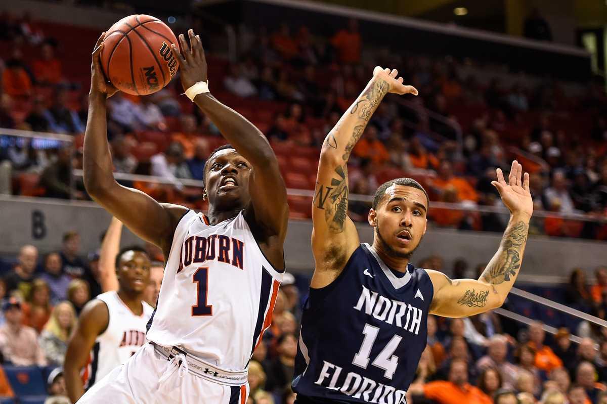 Men's basketball drops season opener