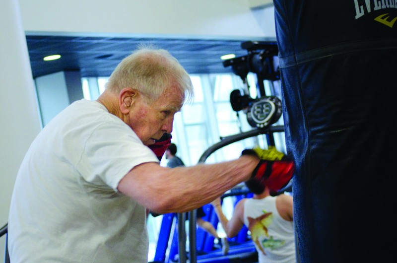 Ken Comyns delivers blows to the punching bag in the UNF Student Wellness Complex.  Photo by Ali Blumenthal
