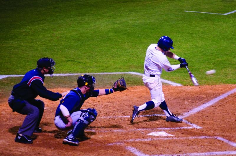 Photo Credit: Ali Blumenthal Kyle Brooks takes a swing in UNF's first series of the year against WVU