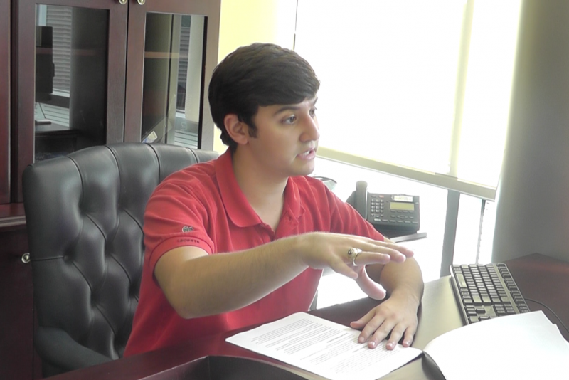 Billy Namen, treasurer during the 2012-13 academic year, explains the discrepancies in the audit of the Volunteer Center. Photo from video by Sarah Ricevuto