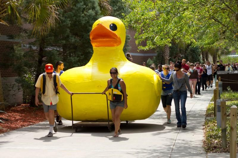 A procession follows the duck on the way to its new home. Photo by Randy Rataj