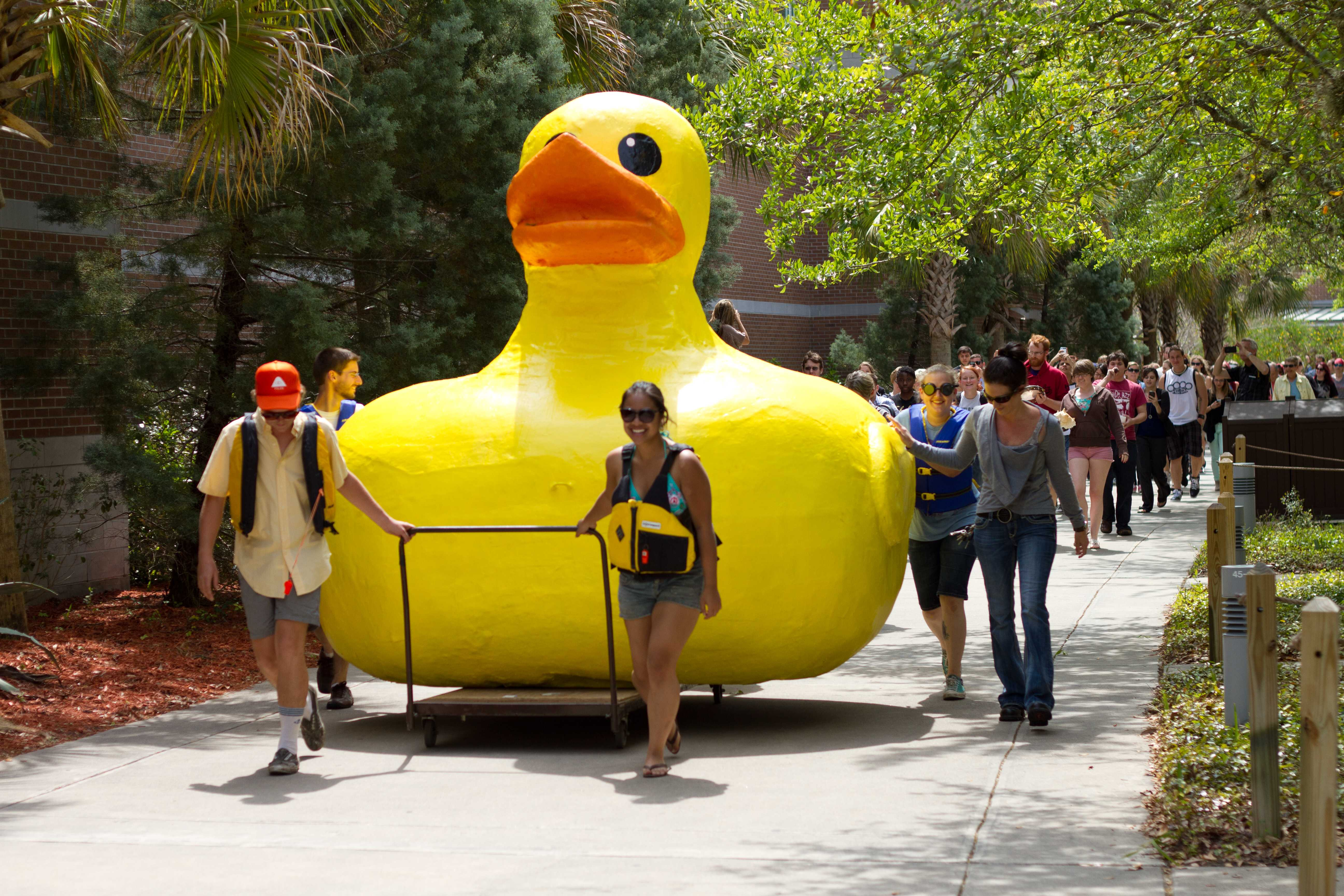 First to review yellow rubber duck click here to cancel reply - A Procession Follows The Duck On The Way To Its New Home Photo By Randy