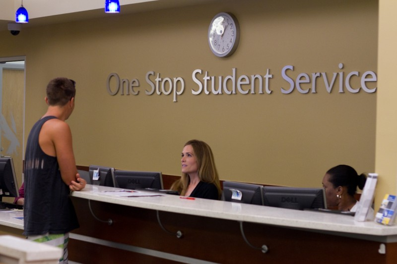 UNF students turn in documentation required to complete a FAFSA at the One Stop Student Services office in Hicks Hall.  Photo by Randy Rataj.