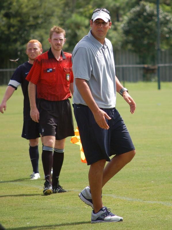 Head coach Derek Marinatos stalks the sideline during the exhibition match against Georgia Southern.