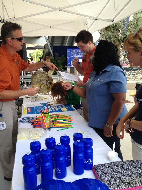 Students participate in a raffle set up by the Florida Lottery. Photo by Lydia Moneir