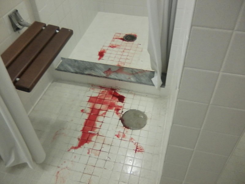 Forrest Gillette tracked blood into the showers of Osprey Hall after cutting his foot on the Green. Photo by Brandon Thigpen