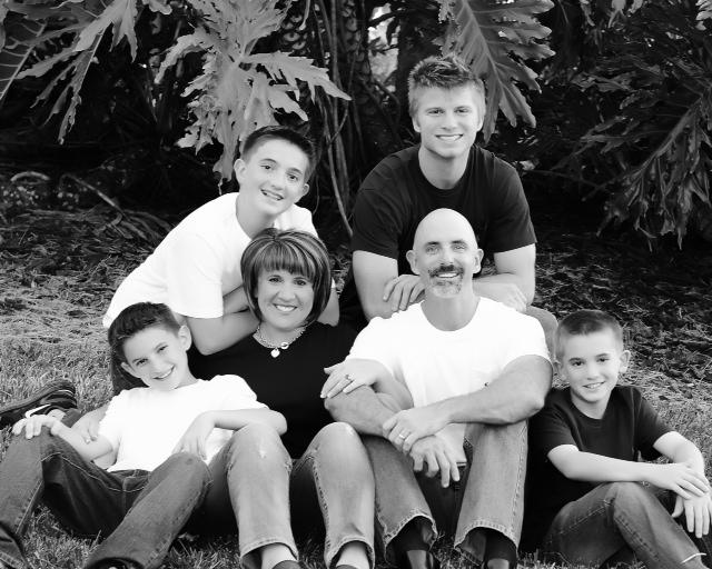 Brad Sienkiewicz, top right, sits with his adopted family, the Ayers family. (Photo provided by Ayers Family)