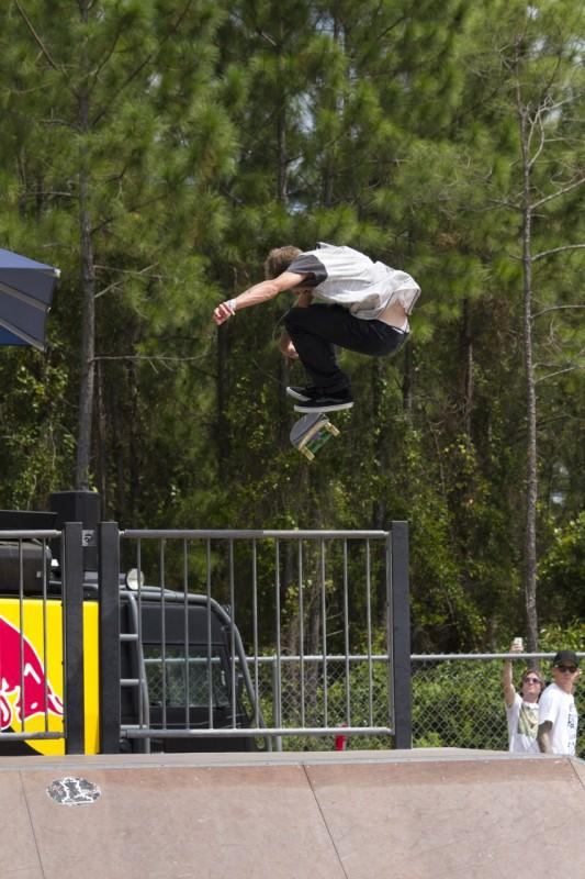 Ethan Sullivan does a kick flip over the railing. Photo by Randy Rataj