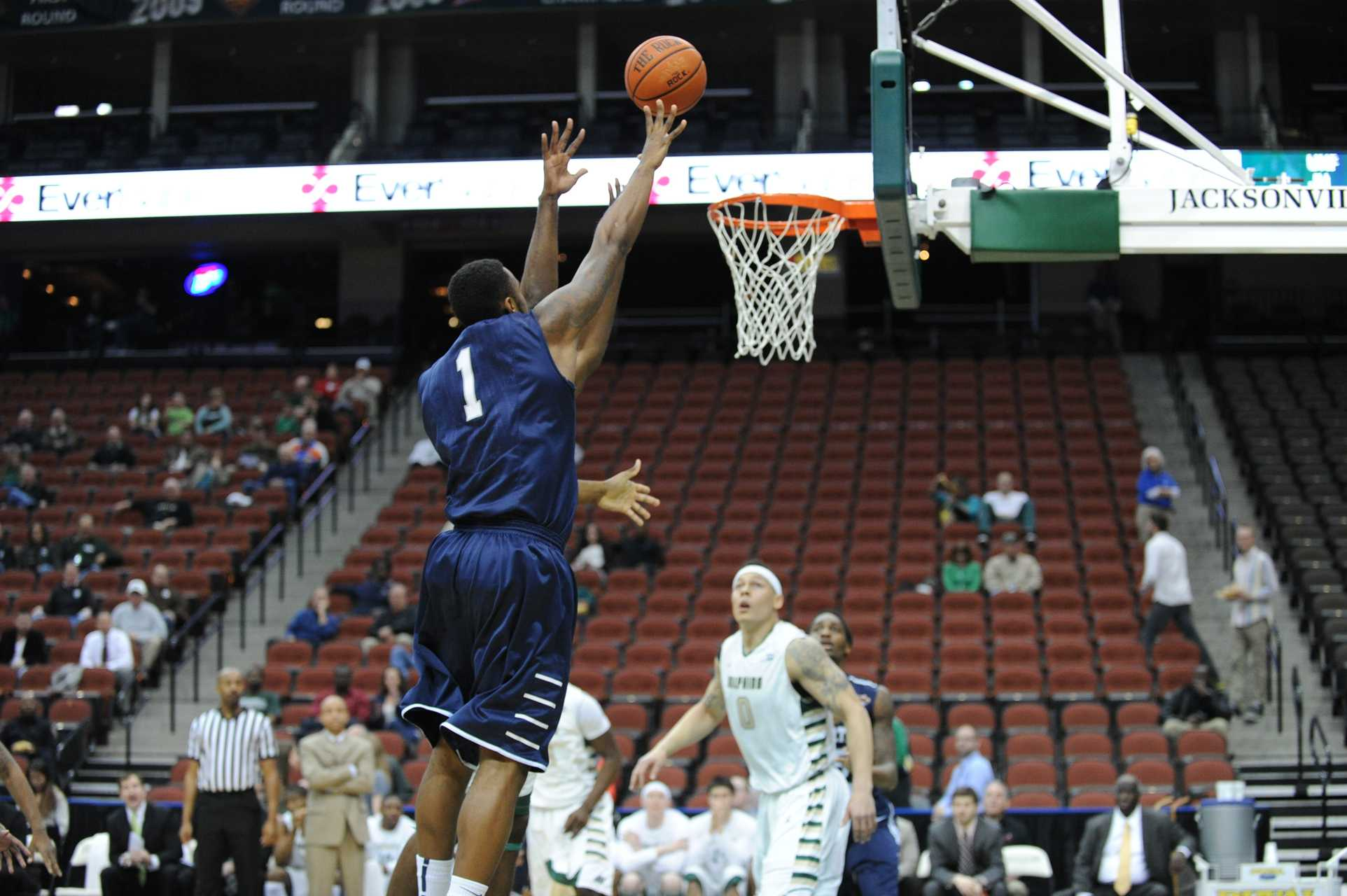 Travis Wallace attempts a layup in a previous game against JU.  Wallace finished iwth 18 points in the upset vs Mercer. Photo by John Shippee