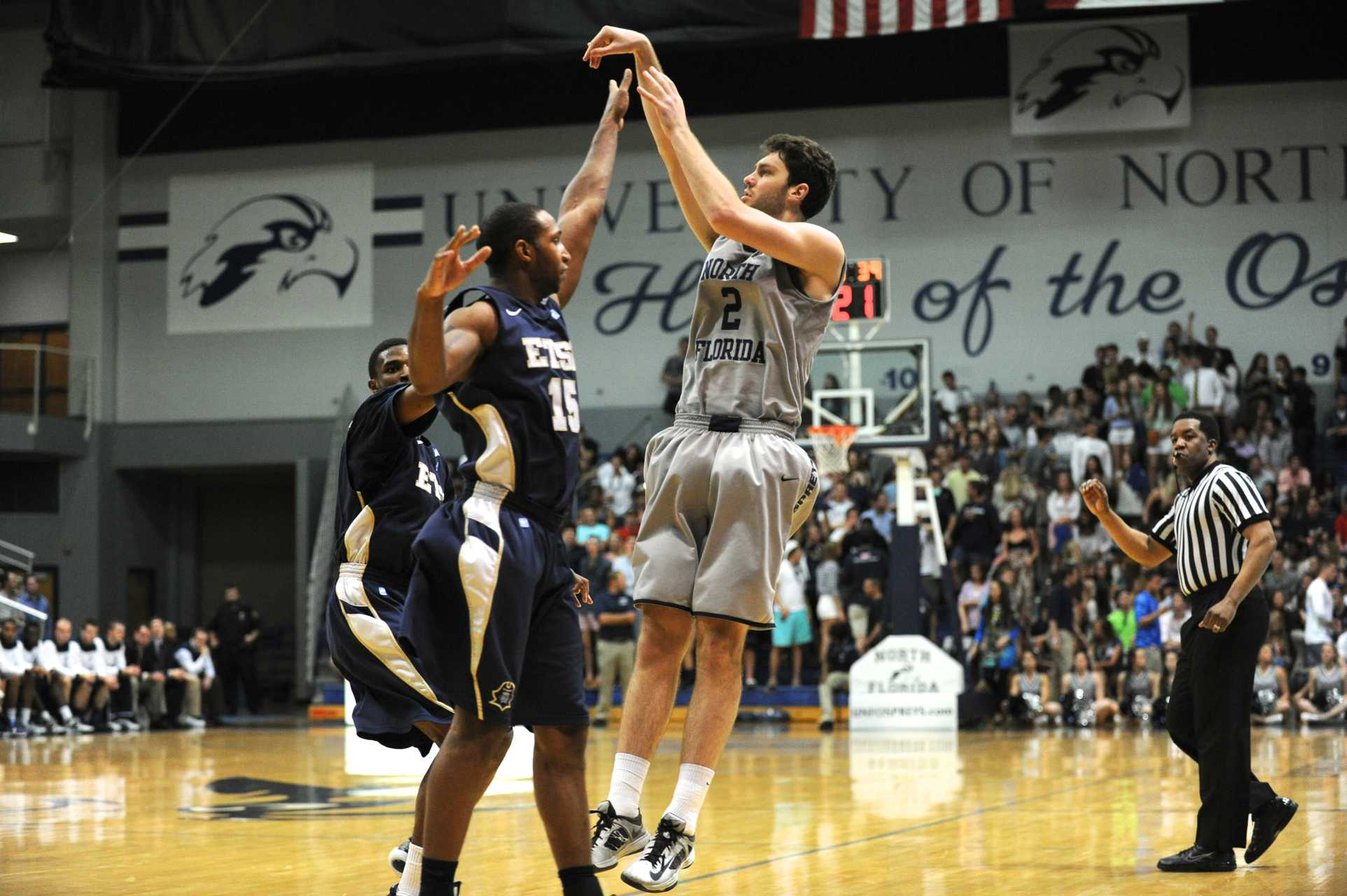 Beau Beech attempts a three with an ETSU defender's hand in his line of view. Photo by John Shippee