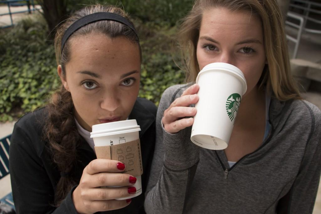 Ebony Gunn, athletic training major, and Cameron McGuire, public relations major, get their caffeine fix before their afternoon volleyball practice. Photo by Bronwyn Knight.