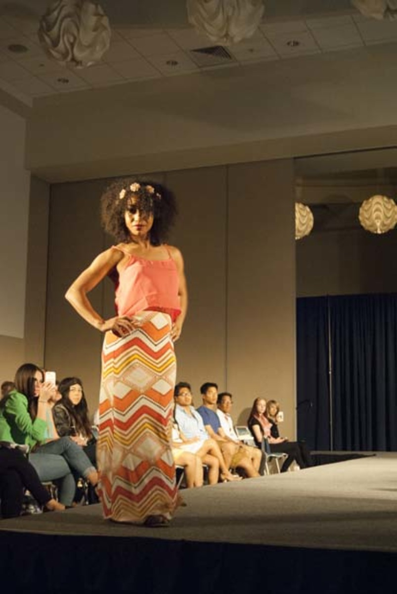 Yasha Albright, health administration senior, poses at the end of the runway. Photo by Camille Shaw