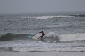 UNF Surf Team member Patrick Nichols rides the waves. Photo courtesy of Adam Bartoshesky.