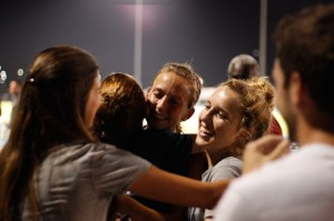 Friends and teammates congratulate Elle Baker on her 10th place finish. Photo by Joshua Brangenberg.