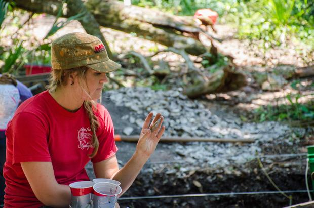 Jessica Jones examines the artifact her classmates have found. Photo by Robert Curtis