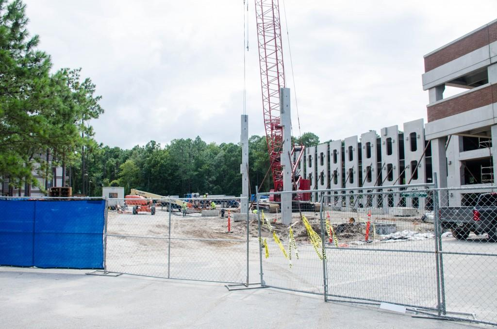 The new parking garage is being built right behind the villages.  Photo by Robert Curtis