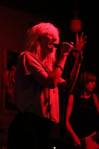 Mish Way , of White Lung, rocks out on stage during her band's set. Photo by Michaela Gugliotta