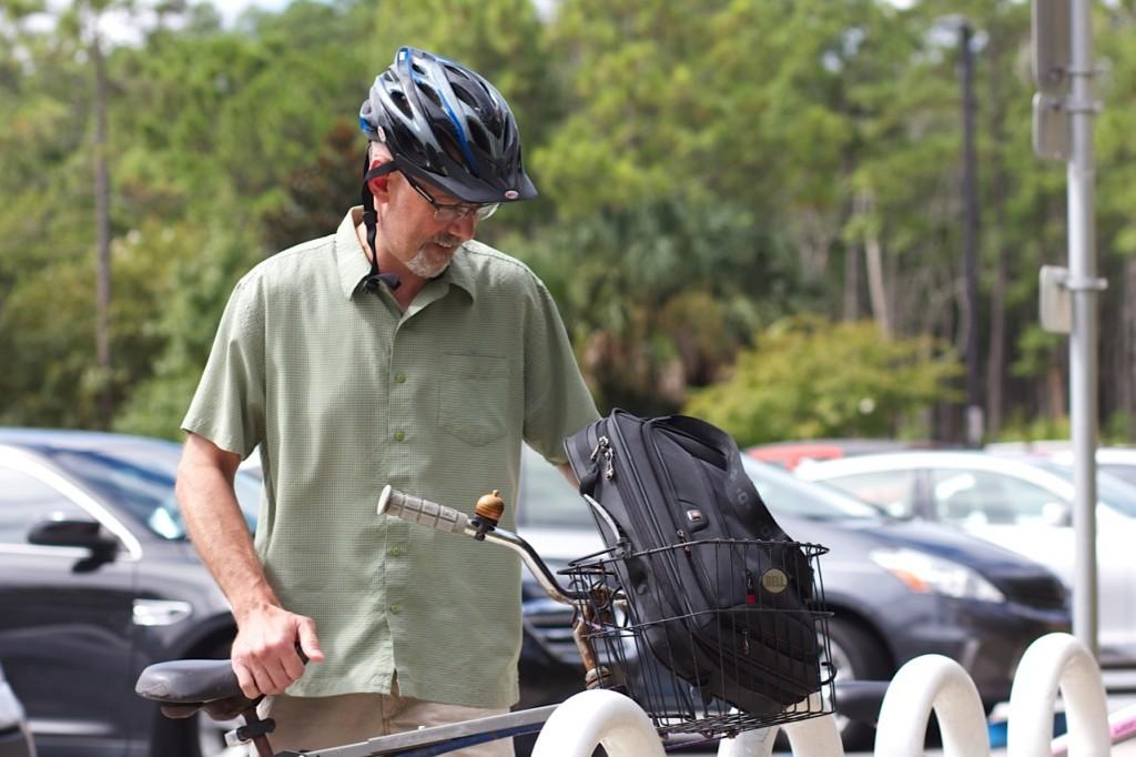 John White, Ph.D, associate professor in the Department of English Education, has to ride his bike from a far away lot.Photo by Blake Middleton