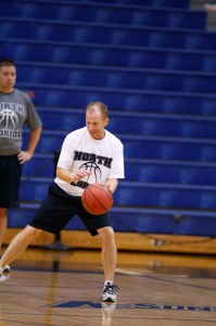 Coach Driscoll demonstrates proper dribbling form.