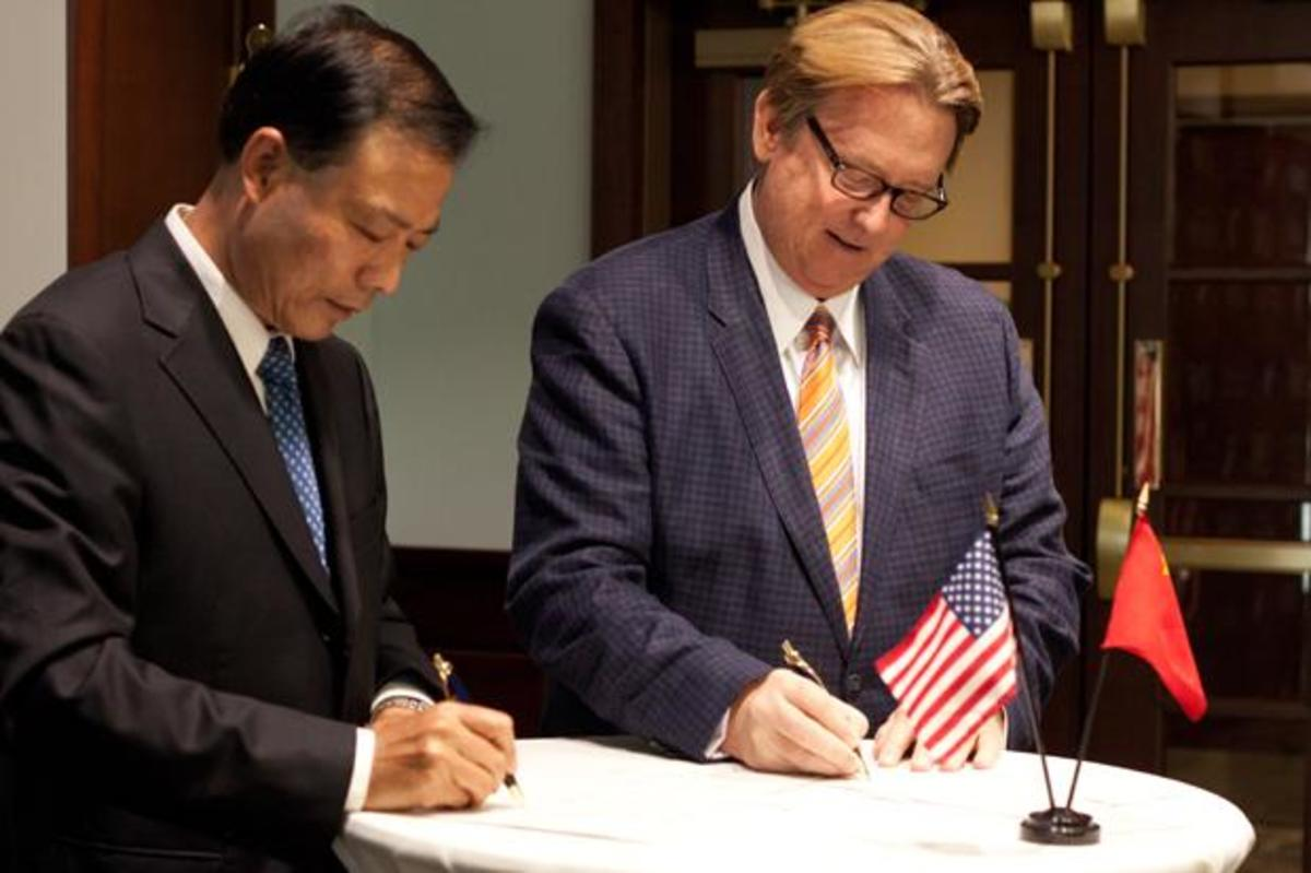 President John Delaney and Jianxiang Zhang, Shaanxi Normal University's Vice Director of International Programs, signed the agreement that will send students between the schools to study abroad. Photo by Joshua Brangenberg