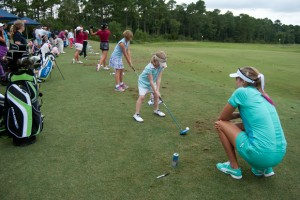 Thompson supervises up and coming golfers as they practice their swing. Photo by Camille Shaw