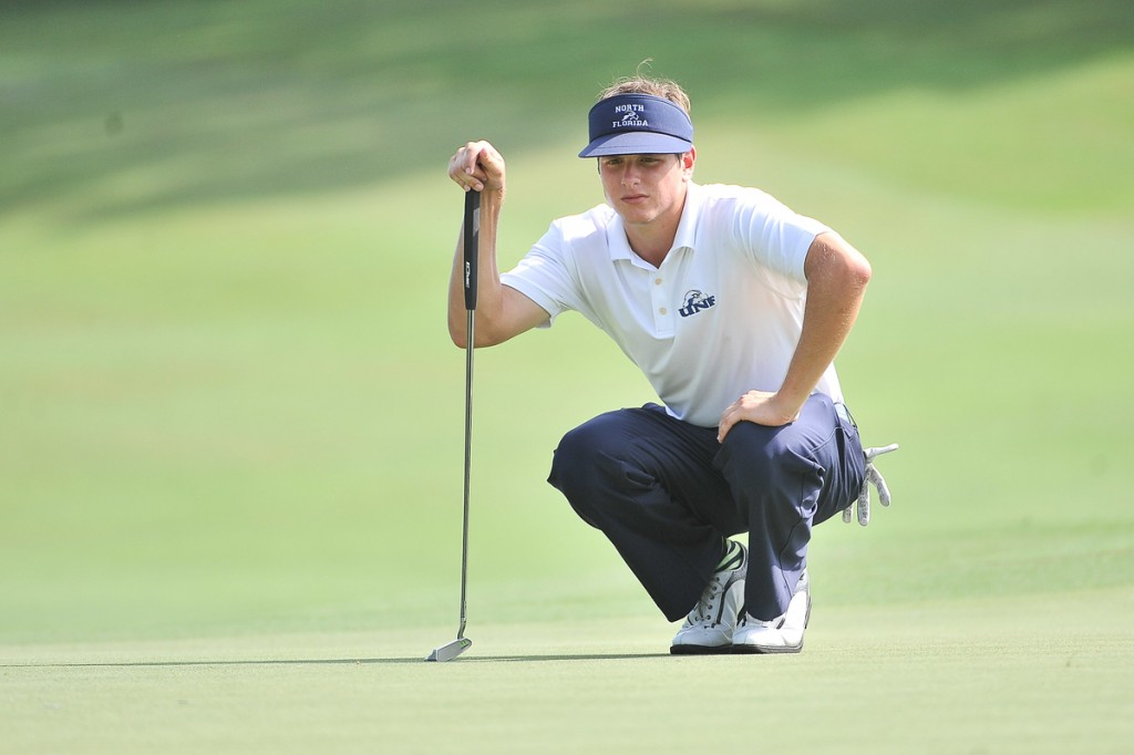UNF'S Joey Petronio concentrates on the line of the putt. Photo by Chuck White