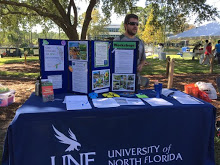 UNF's Ogier Gardens tables at the Garbage on the Green event. Photo by Marielisa Martinez