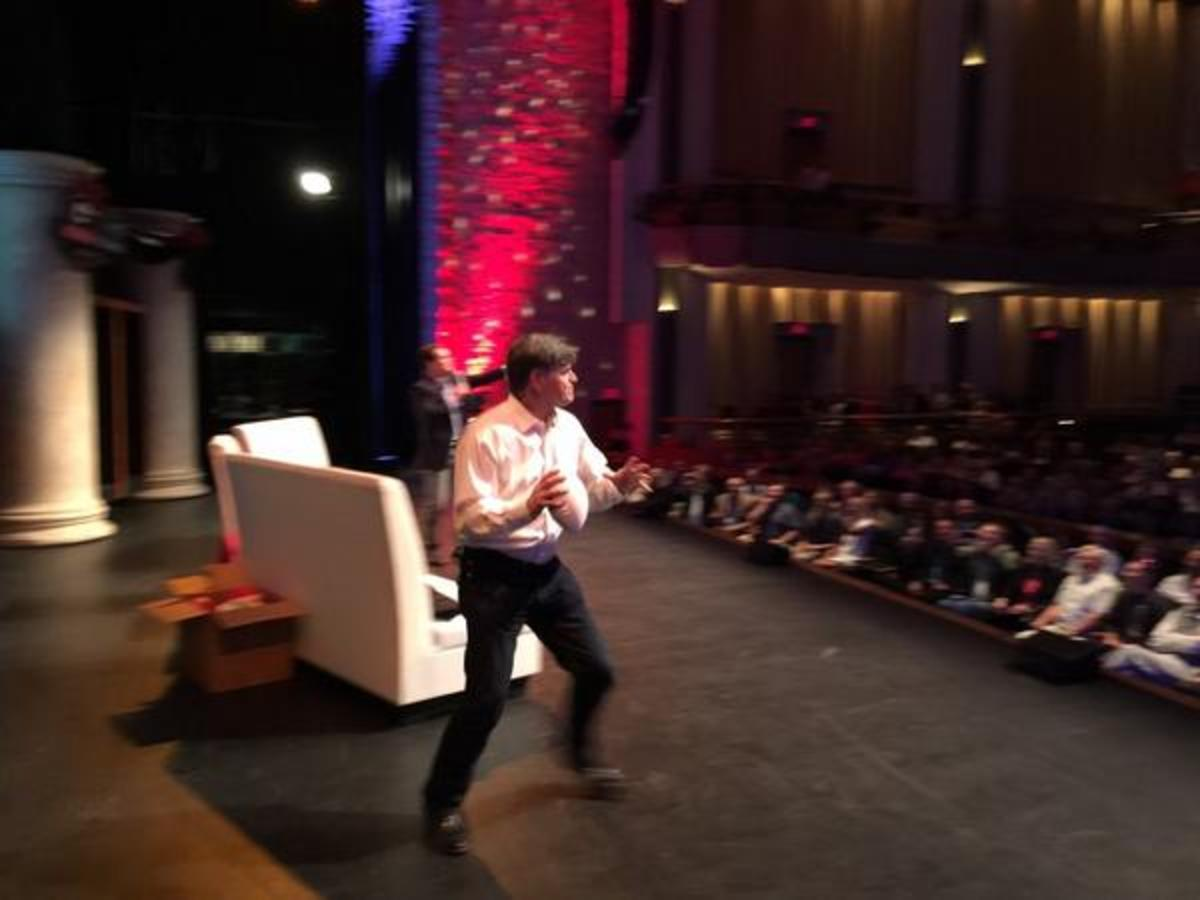 Hannity throws a football to audience members to get them revved up for Stand Up for AmericaPhoto courtesy of Sean Hannity's Twitter
