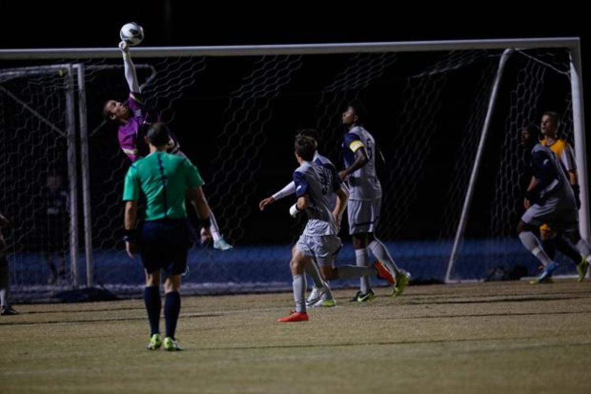 Kyle Nasta (1) makes a huge save from a corner kick.Photo by Joshua Brangenberg
