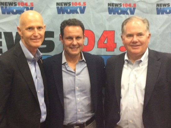 Rick Scott, Brian Kilmeade and Rush Limbaugh pose in front of WOKV news.  Photo courtesy WOKV