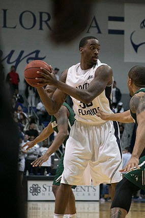 Earlier this season, Chris Davenport (35) holds the ball against JU defense on Feb. 6. Photo by Camille Shaw