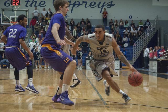 Dallas Moore (14) makes his way around Lipscomb defense. <em>Photo by Morgan Purvis</em>