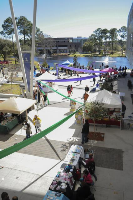 unf market day celebrates mardi gras with beads and