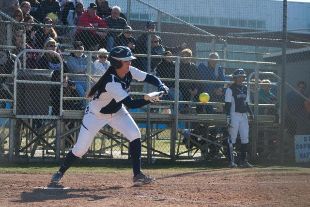 Softball drops home opener