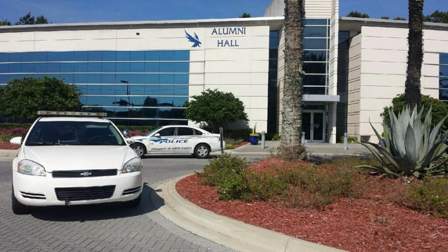 Suspicious person at Alumni Hall waves stick and flees