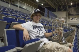 Putnam poses with his baritone horn. Photo by Morgan Purvis